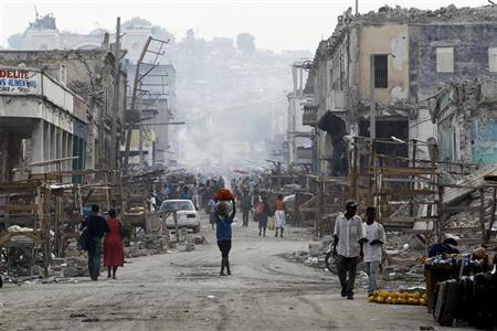 People walk on a street in downtown Port-au-Prince January 9, 2011. REUTERS/Jorge Silva