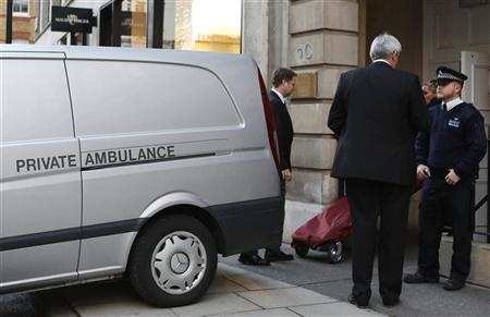 A stretcher is brought from a private ambulance into the block of flats where the nurse Jacintha Saldanha lived near the King Edward VII Hospital in central London December 7, 2012. A female nurse who took a prank call at the London hospital that treated Prince William's pregnant wife Kate for morning sickness has been found dead, the hospital said on Friday. REUTERS/Olivia Harris