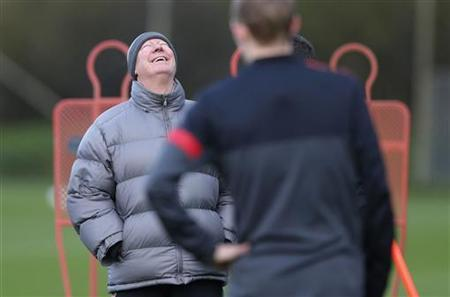 Manchester United's manager Alex Ferguson (L) laughs during a training session at the club's Carrington training complex in Manchester, northern England December 4, 2012. REUTERS/Phil Noble