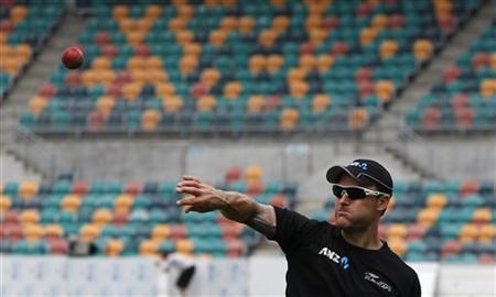 New Zealand's Brendon McCullum bowls during a practice session in Hobart December 8, 2011. REUTERS/Daniel Munoz/Files
