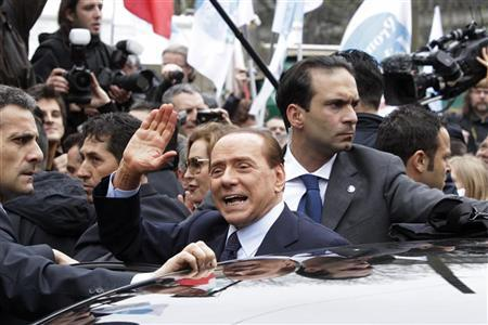 Silvio Berlusconi gestures as he leaves the Justice Palace in Milan March 28, 2011. REUTERS/Alessandro Garofalo/Files
