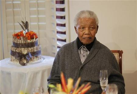 Former South African president Nelson Mandela looks on as he celebrates his birthday at his house in Qunu, Eastern Cape July 18, 2012. REUTERS/Siphiwe Sibeko/Files