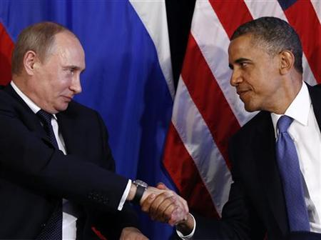 U.S. President Barack Obama (R) shakes hands with Russia's President Vladimir Putin in Los Cabos, Mexico, June 18, 2012. The leaders are in Los Cabos to attend the G20 summit. REUTERS/Jason Reed/Files