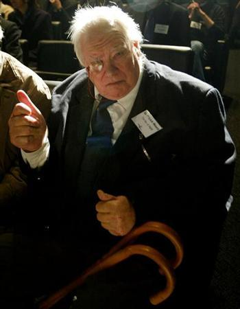 British astromoner Sir Patrick Moore attends a news conference as it is announced that the Beagle 2 lander craft has separated from the mother ship Mars Express on its way towards Mars, in London, December 19, 2003. REUTERS/Russell Boyce