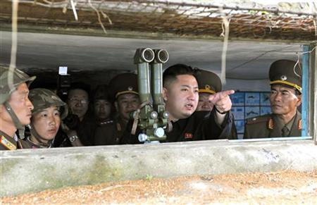 North Korean leader Kim Jong-Un (C) visits a military unit on an island in the most southwest of Pyongyang in this picture released by the North's official KCNA news agency in Pyongyang August 18, 2012. REUTERS/KCNA