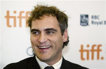 Actor Joaquin Phoenix arrives on the red carpet for the gala presentation of the film ''The Master'' at the 37th Toronto International Film Festival, September 7, 2012. REUTERS/Mark Blinch/Files