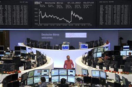 Traders are pictured at their desk under the DAX board at the Frankfurt stock exchange December 7, 2012. REUTERS/Remote/Lizza David