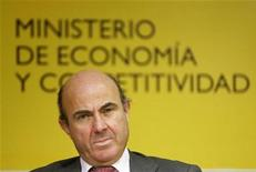 Spanish Economy Minister Luis de Guindos attends a joint news conference with Organisation for Economic Co-operation and Development (OECD) Secretary General Jose Angel Gurria (unseen) in Madrid November 29, 2012. REUTERS/Andrea Comas