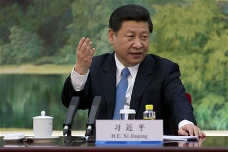 China's newly appointed leader Xi Jinping gestures as he attends a meeting with a panel of foreign experts at the Great Hall of the People in Beijing December 5, 2012. REUTERS/Ed Jones/Pool