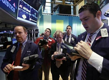 Traders work on the floor of the New York Stock Exchange, December 5, 2012. REUTERS/Brendan McDermid