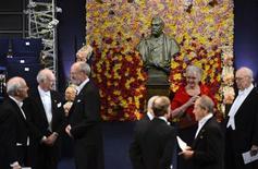 Guests gather near a bust of dynamite inventor Alfred Nobel in the Stockholm Concert Hall prior to the Nobel prize award ceremony in Stockholm December 10, 2012. REUTERS/Henrik Montgomery/Scanpix