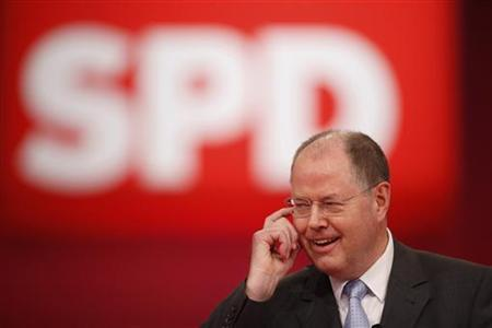 Designated top candidate of the German Social Democratic Party (SPD) for the 2013 German general elections, Peer Steinbrueck speaks during the extraordinary party meeting of the SPD in Hanover, December 9, 2012. Steinbrueck on Sunday was elected as the SPD's top candidate for Germany's 2013 general elections. REUTERS/Ralph Orlowski (GERMANY - Tags: POLITICS)