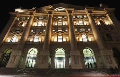 The main entrance of Milan's stock exchange is pictured in Milan December 10, 2012. REUTERS/Stefano Rellandini