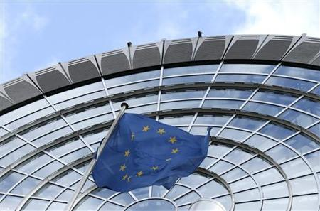 An European Union flag flutters outside of the European Parliament in Brussels October 12, 2012. REUTERS/Francois Lenoir/Files