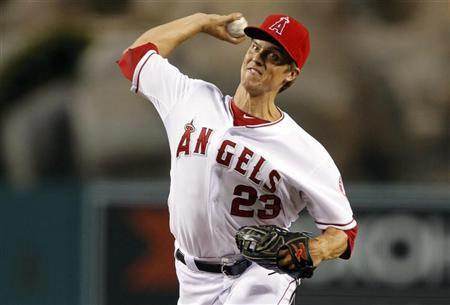 Los Angeles Angels starting pitcher Zack Greinke delivers a pitch against the Texas Rangers during the first inning of their MLB baseball game in Anaheim, California September 20, 2012. REUTERS/Alex Gallardo