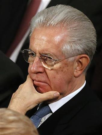 Prime Minister of Italy Mario Monti listens to a speaker during the Nobel Peace Prize ceremony at City Hall in Oslo December 10, 2012. European partners heaped praise on Monti on Monday, and called for the next government to stick to his reform agenda after his surprise decision to resign rattled financial markets. REUTERS/Suzanne Plunkett (NORWAY - Tags: POLITICS BUSINESS)