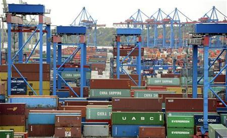 Huge van carriers transport containers at the container terminal ''Burchardkai'' of the Hamburger Hafen und Logistik AG (HHLA) in the harbour of Hamburg October 17, 2012. REUTERS/Fabian Bimmer (GERMANY - Tags: BUSINESS MARITIME)