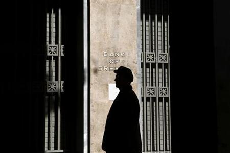 An elderly man walks outside the Bank of Greece in Athens November 9, 2012. REUTERS/Yorgos Karahalis