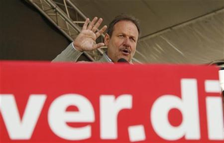 Frank Bsirske, head of the public service sector union Verdi delivers a speech at a demonstration of several thousand workers of the public sector in Cologne March 21, 2012. REUTERS/Wolfgang Rattay (GERMANY - Tags: POLITICS BUSINESS EMPLOYMENT CIVIL UNREST)