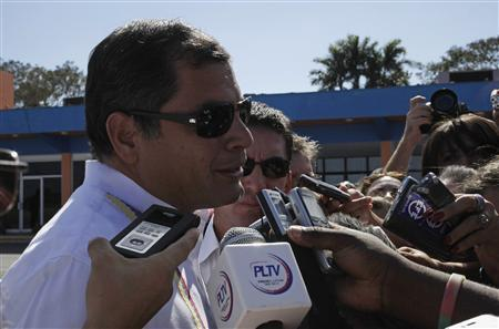Ecuador's President Rafael Correa talks to media upon his arrival at Havana's Jose Marti airport December 10, 2012. Correa arrived in Cuba to support Venezuela's ailing President Hugo Chavez, who is undergoing urgent surgery in a top medical facility in Havana for a cancer recurrence. Chavez flew to Cuba on Monday for cancer surgery, vowing to return quickly despite his unprecedented admission the disease could end his 14-year rule of the South American OPEC nation. REUTERS/Enrique De La Osa