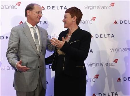 Delta Chief Executive Richard Anderson talks with Virgin Atlantic Chief Financial Officer Julie Southern after a news conference to announce a sale of Virgin Atlantic airline to Delta Air Lines, in New York December 11, 2012. REUTERS/Brendan McDermid