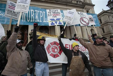 Anti right-to-work protesters yell outside Michigan's state capitol building in Lansing December 11, 2012. REUTERS/Rebecca Cook