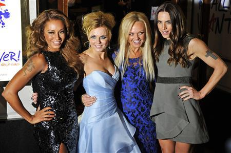 Spice Girl members Melanie Brown (L-R), Geri Halliwell, Emma Bunton and Melanie Chisholm arrive for the premiere of the musical ''Viva Forever!'', based on the music of the Spice Girls, in central London December 11, 2012. REUTERS/Toby Melville