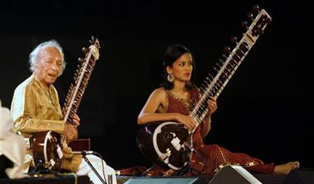 Sitar player Ravi Shankar performs with daughter Anoushka Shankar in Kolkata February 7, 2009. REUTERS/Jayanta Shaw/Files