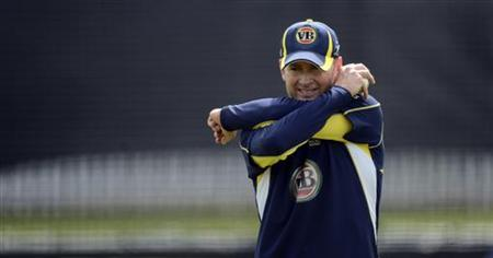 Australia's captain Michael Clarke stretches during a training session before Friday's first one-day international against England at Lord's cricket ground in London June 28, 2012. REUTERS/Philip Brown/Files