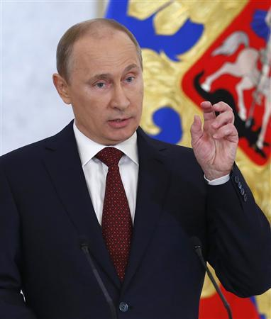 Russia's President Vladimir Putin speaks during his annual state of the nation address at the Kremlin in Moscow December 12, 2012.
