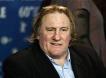 """Actor Gerard Depardieu speaks during a news conference to promote the movie """"Mammuth"""" at the Berlinale International Film Festival in Berlin, February 19, 2010. REUTERS/Christian Charisius"""