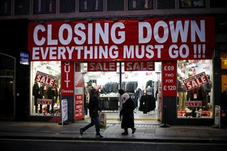 People walk past a business advertising a closing down sale in central London December 5, 2012. REUTERS/Andrew Winning