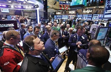 Traders gather at the Barclay's Capital post that trades Berkshire Hathaway stocks on the floor of the New York Stock Exchange, December 12, 2012. REUTERS/Brendan McDermid