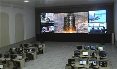 North Korean scientists work as a screen shows the Unha-3 (Milky Way 3) rocket being launched from a launch pad at the West Sea Satellite Launch Site, at the satellite control centre in Cholsan county, North Pyongan province in this picture released by the North's official KCNA news agency in Pyongyang December 12, 2012. KCNA said the picture was taken December 12, 2012. REUTERS/KCNA