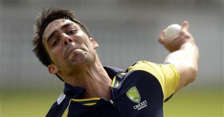 Australia's Mitchell Johnson bowls during a training session before Friday's first one-day international against England at Lord's cricket ground in London June 28, 2012. REUTERS/Philip Brown/Files
