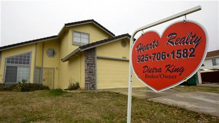 A For Sale sign is displayed in front of a home in Stockton, California February 2, 2008. REUTERS/Kimberly White