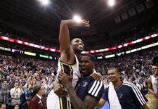 Utah Jazz guard Mo Williams (5) is carried off the court by forward Marvin Williams (2) after hitting the game winning shot at the buzzer ending the second half of their NBA basketball game against the San Antonio Spurs in Salt Lake City, Utah, December 12, 2012. REUTERS/Jim Urquhart