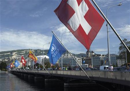 Flags are pictured on the Mont-Blanc bridge over the Lake Leman in Geneva June 5, 2012. REUTERS/Denis Balibouse (SWITZERLAND - Tags: SOCIETY)
