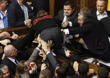 Parliament members scuffle over regulations in forming factions during the first session of the newly-elected Ukrainian parliament in Kiev December 12, 2012. Wednesday's session of the parliament was marred by protests from the start, with a major vote on the nomination of Mykola Azarov for prime minister expected to be the first test of the cohesion of political forces underpinning Ukrainian President Viktor Yanukovich. REUTERS/Anatolii Stepanov
