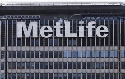 MetLife warns on 2013 profit, expects no stock buybacks