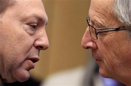 Greece's Finance Minister Yannis Stournaras (L) talks with Luxembourg's Prime Minister and Eurogroup chairman Jean-Claude Juncker during a Eurogroup meeting in Brussels December 13, 2012. Euro zone finance ministers and officials are expected to make a final decision on releasing the next payment of aid to Greece at a meeting in Brussels on Thursday. REUTERS/Yves Herman (BELGIUM - Tags: POLITICS BUSINESS)