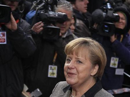 Germany's Chancellor Angela Merkel arrives at an European Union leaders summit in Brussels December 13, 2012. European governments reached a landmark deal on Thursday that gives the European Central Bank new powers to supervise banks, boosting confidence in the single currency bloc as it enters the fourth year of its debt crisis. REUTERS/Yves Herman (BELGIUM - Tags: POLITICS BUSINESS)