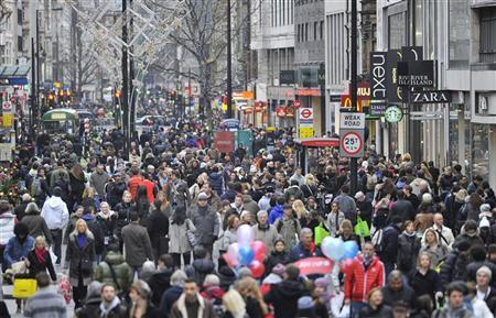Pedestrians walk along Oxford Street after it and Regents Street were closed to vehicle traffic for a pre-Christmas shopping weekend in London December 11, 2011. REUTERS/Toby Melville