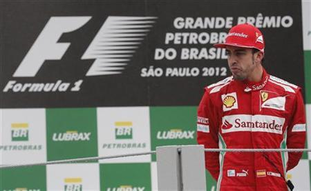 Second placed Ferrari Formula One driver Fernando Alonso of Spain looks on at the podium after the Brazilian F1 Grand Prix at Interlagos circuit in Sao Paulo November 25, 2012. REUTERS/Paulo Whitaker