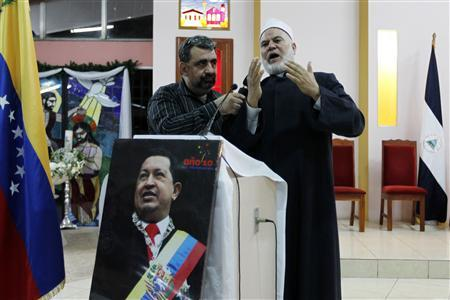 Sheikh Nasef, the Muslim imam of the Mosque of Managua, speaks during a mass to pray for the health of Venezuela's President Hugo Chavez in Managua December 12, 2012. Chavez is in stable condition after his cancer operation in Cuba, Venezuela's Information Minister Ernesto Villegas said on Wednesday. REUTERS/Oswaldo Rivas