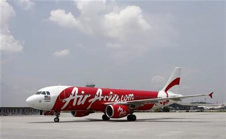 An Air Asia Airbus A320-200 aircraft approaches its parking space at the Low Cost Carrier Terminal (LCCT) in Sepang, outside Kuala Lumpur March 21, 2012. REUTERS/Tim Chong/Files