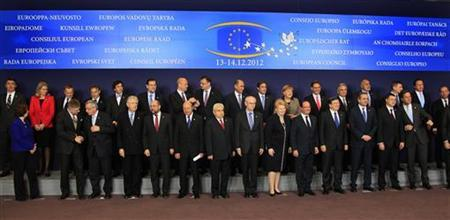 European Union leaders pose for a family photo during a EU summit, in Brussels December 13, 2012. European governments reached a landmark deal on Thursday that gives the European Central Bank new powers to supervise banks, boosting confidence in the single currency bloc as it enters the fourth year of its debt crisis. REUTERS/Yves Herman (BELGIUM - Tags: POLITICS BUSINESS)