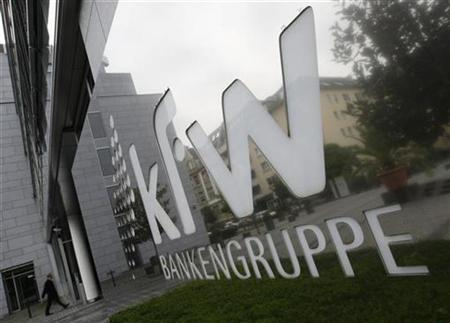 A man walks outside the local branch of the KfW bank in Frankfurt October 22, 2008. German authorities raided the offices of state bank KfW on Wednesday probing KfW's transfer of funds to Lehman Brothers after the U.S. bank had filed for bankruptcy protection, Frankfurt prosecutors said. REUTERS/Alex Grimm (GERMANY)