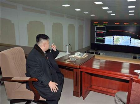 North Korean leader Kim Jong-Un smokes a cigarette at the General Satellite Control and Command Center after the launch of the Unha-3 (Milky Way 3) rocket carrying the second version of Kwangmyongsong-3 satellite at West Sea Satellite Launch Site in Cholsan county, North Pyongan province December 12, 2012, in this picture released by the North's KCNA news agency in Pyongyang December 13, 2012. REUTERS/KCNA