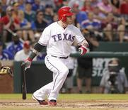 Texas Rangers Josh Hamilton follows though on a two-run triple against Oakland Athletics pitcher Tommy Milone in the first inning of their MLB American League baseball game in Arlington, Texas September 25, 2012. REUTERS/Tim Sharp